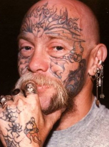 Man with a tattoo face.