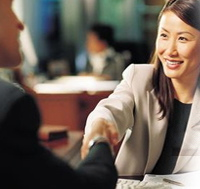 Woman shaking hands after a great job interview.