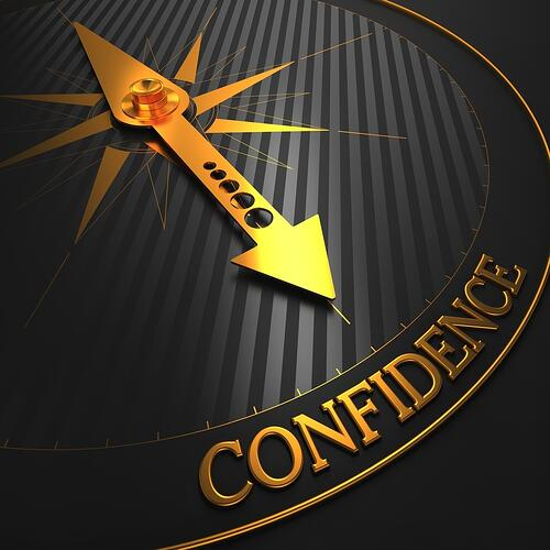 Confidence - Business Background. Golden Compass Needle on a Black Field Pointing to the Word