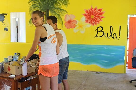 Two GeoVisions volunteers abroad in Fiji working on a renovation project for a classroom in their town.