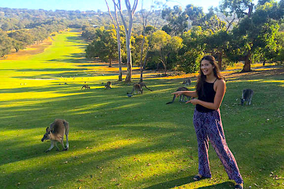 A GeoVisions au pair on a golf course in Australia with kangaroo.