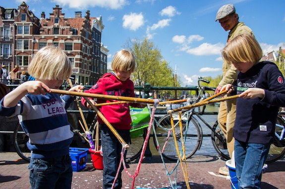 Dutch children outside playing a game with their GeoVisions au pair.