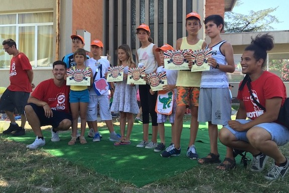 A group of language campers with 3 of their GeoVisions counselors holding their certificates.
