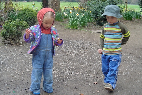 Two children outside playing with their GeoVisions au pair in Ireland.