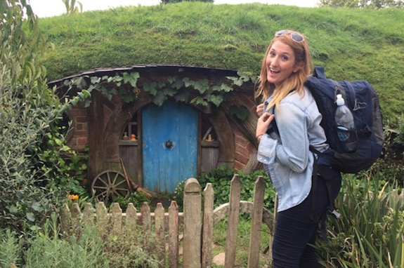 A GeoVisions au pair visiting Hobbiton in New Zealand, taking a break from her host family.