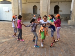 Day campers in Italy playing English games outside at the language camp.