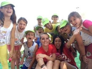 A GeoVisions Foundation language camp counselor with her day campers learning English.