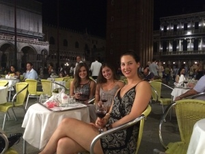 While the family was on vacation, Kayla traveled through Italy. This picture is in the Piazza San Marco in Venice with two other Canadians she met.