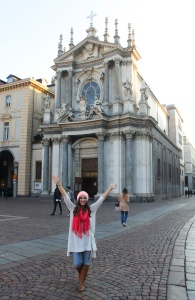 A GeoVisions au pair in Italy in front of a church.
