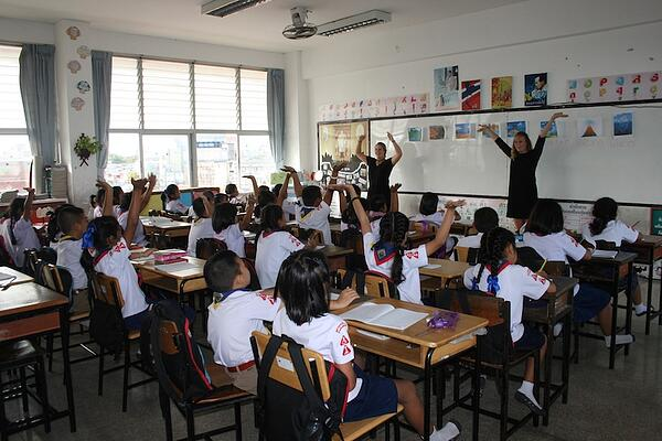 A GeoVisions teacher in a classroom in Thailand.