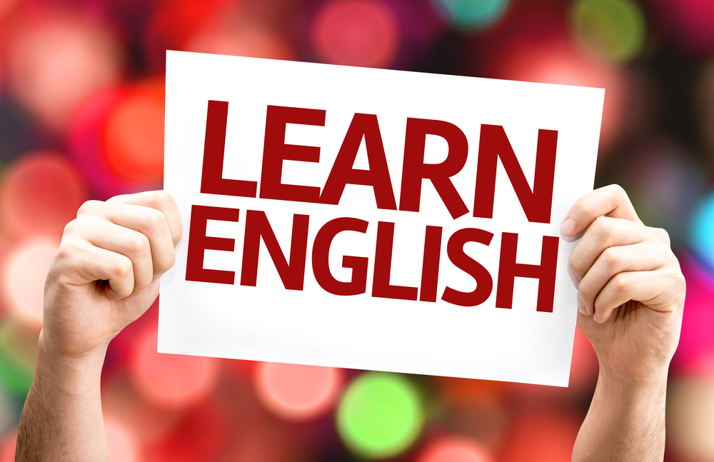 Learn English card with colorful background with defocused lights